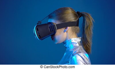 Woman wearing virtual reality googles looking at blank copy...