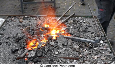 Blacksmith fire with hot metal