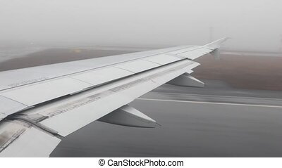 Airplane on its takeoff run in low visibilty foggy weather