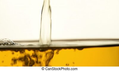 Green tea pouring in glass teapot close up - Stream of hot...