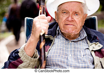 Angry Old Man - An angry old man with his fist up and...