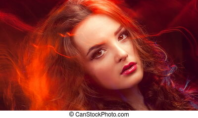 Close up portrait of young beautiful woman looking at...