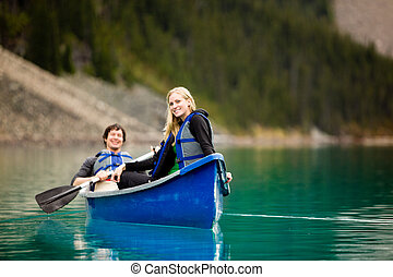 Couple Canoeing and Relaxing - A portrait of a happy woman...