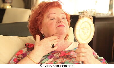 Senior woman applying anti-wrinkles cream - Senior woman...