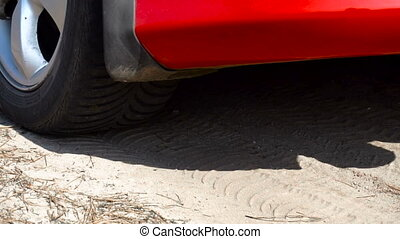 car goes in the sand in slow motion