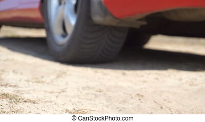 car starts in the sand dust in slow motion