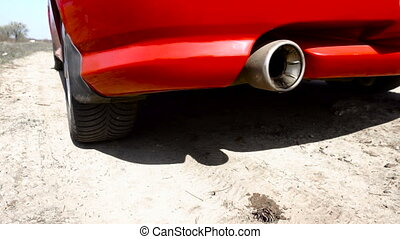 oil and smoke flying out of the exhaust pipe of the car