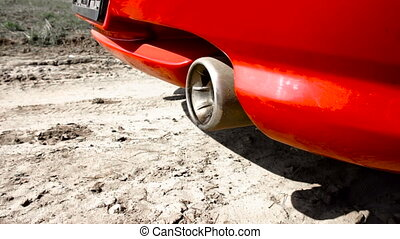 smoke and oil flying out of the exhaust pipe of the car -...