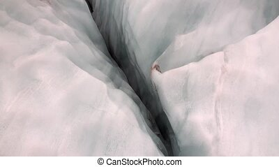 Cleft of glacier in snowy cold mountains of New Zealand.
