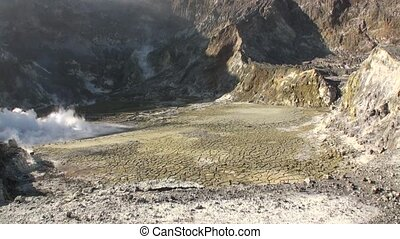 Geysers hot springs in the mountains on the White Island in...