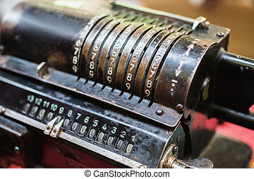 Calculating machine. Old metal computing equipment. Antiques
