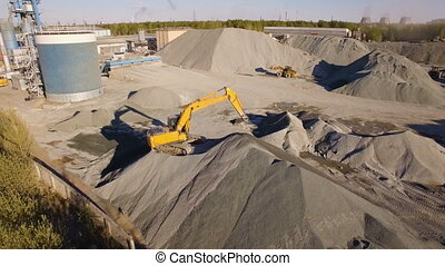 asphalt-concrete plant with running excavators and...