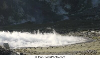 Geysers of a volcano in the mountains on the White Island in New Zealand.