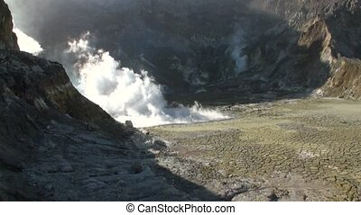 Geysers of a volcano in the mountains on the White Island in...