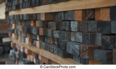 Background of the square ends of the wooden bars. Wood...