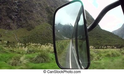 Road trip in the green mountains of New Zealand. Scenic...