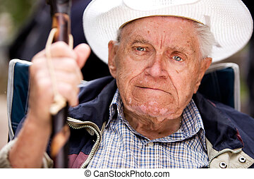 Grumpy Old Man - A portrait of a grumpy old man sitting in a...