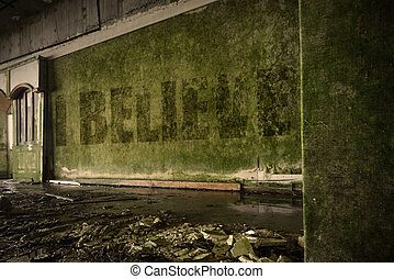 text i believe on the dirty wall in an abandoned ruined...