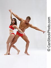 Sexy couple of bodybuilders together in studio - Young sexy...