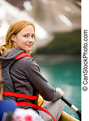 Woman in Canoe - A portrait of a smiling woman in a canoe on...