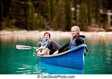 Couple Relaxing in a Canoe