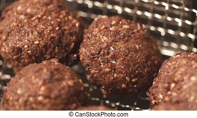 Tasty balls of forcemeat with brown crust.