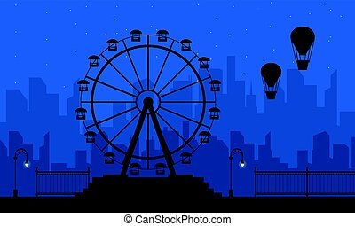 Amusement park scenery at night silhouettes