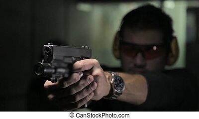 Man shooting a gun with audio