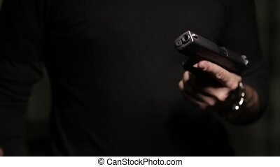 Extortion at gunpoint - Man in black extortion at gunpoint