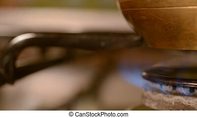 The home coffee in stove. The cezve turk stands and cooks on...