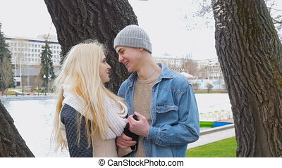 A beautiful blonde and her boyfriend are talking on a date....