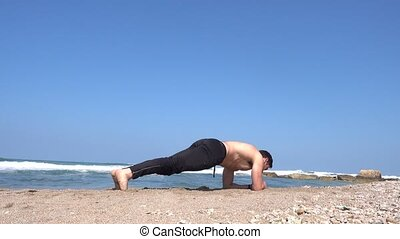 shirtless guy doing static plank exercise