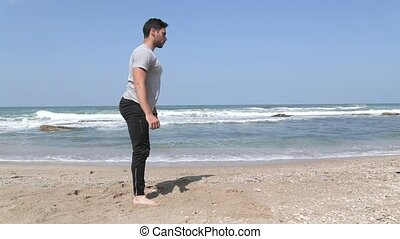 side view on squat exercise - Man doing squat exercise
