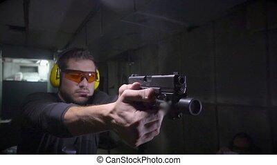 Front side angle of shooter in slow motion - shooting...