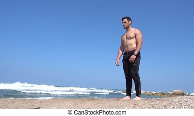 low angle view squat exercise - Squat exercise on the beach