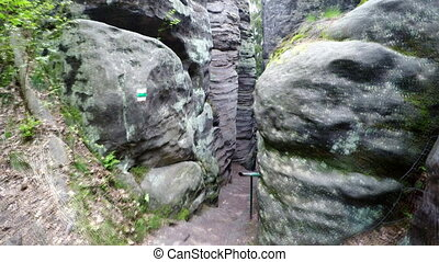 Walk in narrow path in corridor between great sand rocks....