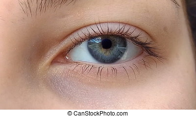 Eye Zoom to Space Travel - A beautiful girl opens her eyes,...
