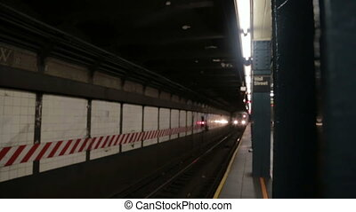 New York subway train arriving at the station Wall Street....