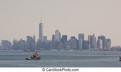 Tow ship sails on the Hudson River on Manhattan in New York...