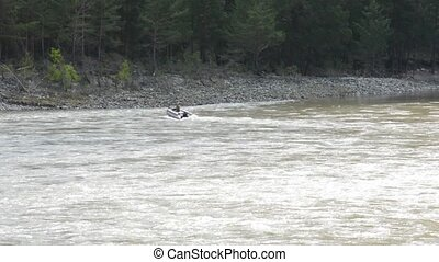 boat River Katun Altai - Spring. A motor boat approaches the...