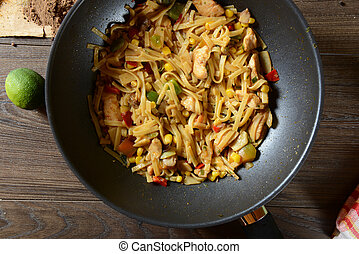Traditional indonesian meal bami goreng with noodles,...