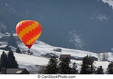 Colorful hot air balloon flying against a blue sky...