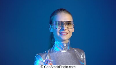 Woman in silver clothing wearing eyeglasses pressing virtual...