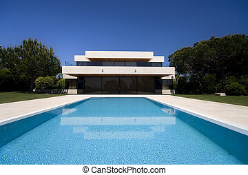 Outdoors - A luxury modern house with a big swimmingpool-...