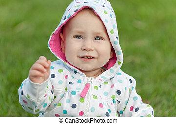 Little girl in the polka dot jacket
