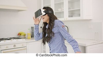 Excited female in VR headset - Beautiful young brunette in...