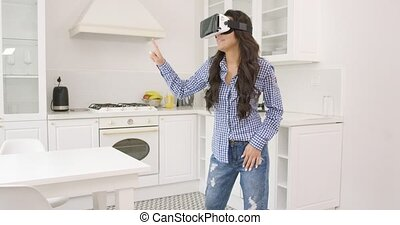 Female in VR glasses at home - Young brunette in casual...