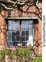 Window of timber-framed Tudor-style house