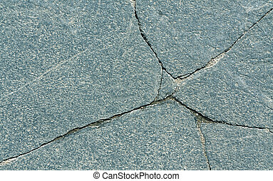 Cracked stone surface.