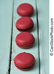 red macarons on a blue rustic table